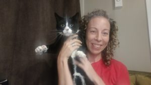 impressed woman with unimpressed cat